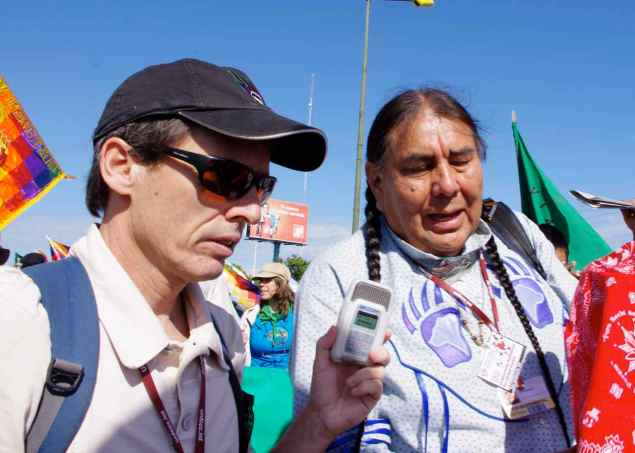 Leahy int Tom Goldtooth sml - cancun march - renee leahy 2010