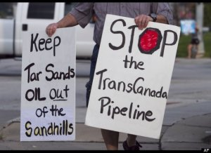 tar sands pipeline protest signs