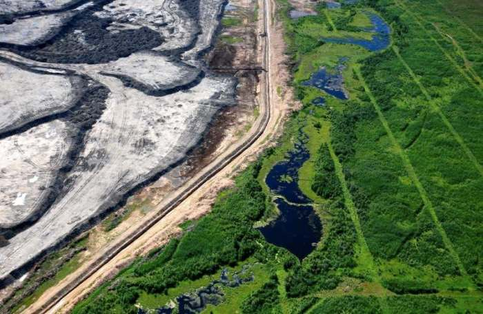 tar sands - visible from space,tarnished earth