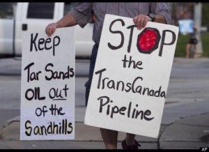 Keystone XL pipeline protest signs